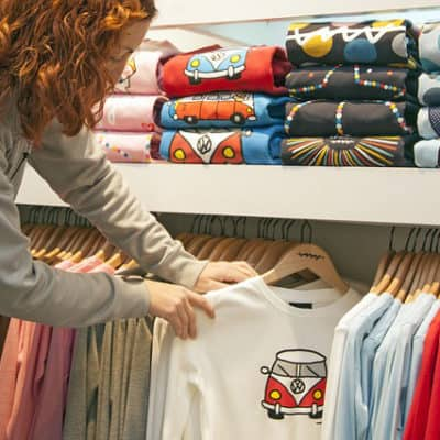 Lady selling through ecommerce checking tshirt